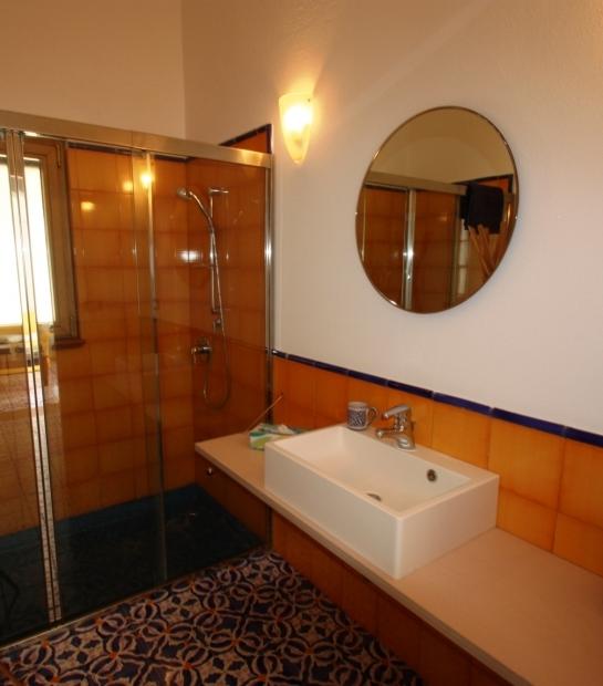 Bathroom with shower by Villa Scauri